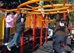 Child on play equipment in West Street Playground