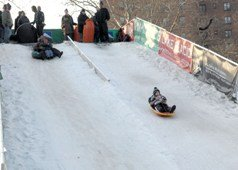 Child sledding at Winter Jam NYC