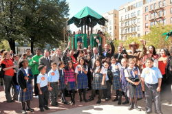Cutting the ribbon with students from St. Athanasius School at Fox Playground.