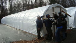 Supervisor David Tapia takes a break from winterizing a hoop house with the Bronx Pact Horticulture crew.