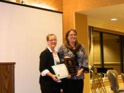 Jessica Kratz receiving Service Award from MaryLynne Malone, President of NYSOEA