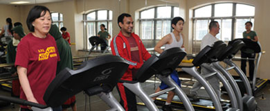 People exercising on treadmills in workout room
