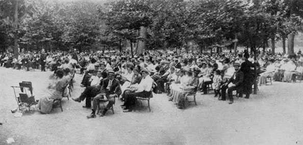 A crowd in Prospect Park enjoys a musical performance in 1910. Neg. AR605