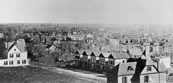 """View from proposed Park at Ridgewood, Garden City in distance,"" high atop a hill, circa 1889."