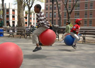 Children riding bouncy balls at Street Games