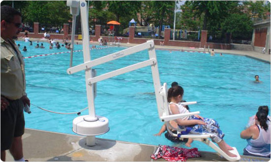 A child gets lowered into the Hamilton Fish outdoor pool on June 28, 2008