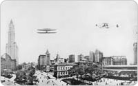 Panorama with Biplane Overhead and Old Post Office, 1913, Irving Underhill