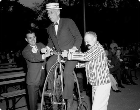 Parks Commissioner August Heckscher attempts to ride a penny-farthing at the Central Park Bicycle Bash, May 23, 1967. Courtesy of Parks Photo Archive; Neg. 40054-3.