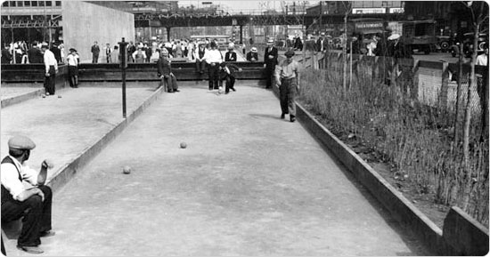 Men enjoy a game of bocce on the courts at 1st Avenue and East Houston, June 5, 1935. Courtesy of Parks Photo Archive, Neg. 1451.