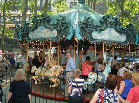 Ribbon cutting at Le Carrousel in Bryant Park, Manhattan. June 11, 2002. Photo: Malcolm Pinckney.