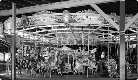 Children enjoy a ride on The Muller Carousel in Forest Park, September 15, 1940. Courtesy of Parks Photo Archive, Neg. 19106.