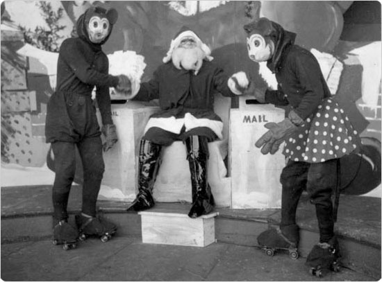 Santa shaking hands with Mickey and Minnie Mouse at the Central Park Bandshell, December 1935. Courtesy of Parks Photo Archive, Neg. 6736.