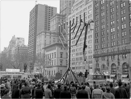 The menorah lighting in Grand Army Plaza by the Lubavitch sect, with then-New York City Mayor Beame, December 1977. Photo by Daniel McPartlin; courtesy of Parks Photo Archive, neg. 41861-5.