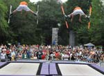 Two people performing trampoline acrobatics