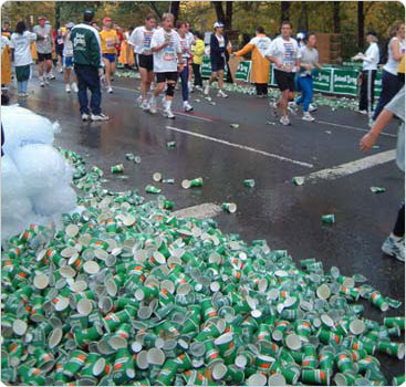 Piles of empty cups amass along the marathon route. During the race, volunteers hand out 2,250,000 paper cups to thirsty runners. Photo by Malcolm Pinckney, November 4, 2001.