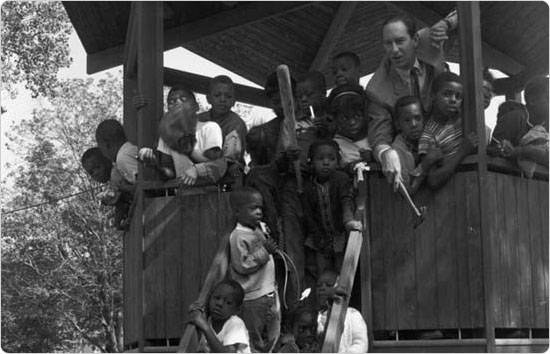 Parks Commissioner Thomas Hoving poses with children at the pavilion in Tompkins Park, Brooklyn on August 8, 1966. Courtesy of Parks Photo Archive; Neg. 32622.
