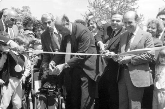 Opening ceremonies for the Playground for All Children in Flushing Meadows Corona Park, including Parks Commissioner Henry Stern, Mayor Ed Koch, Queens borough president Donald Manes, and City Comptroller Harrison J. Goldin, June 1984. Courtesy of Parks Photo Archive; Neg. 42255.