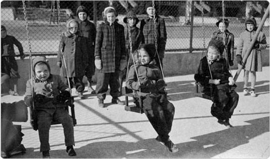 Children enjoy the swings at Paerdegart Park in Brooklyn, January 9, 1943. Courtesy of Parks Photo Archive; Neg. 21960.