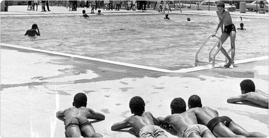 Image of Children soak in the sun at the Kosciusko wading pool, circa 1971.