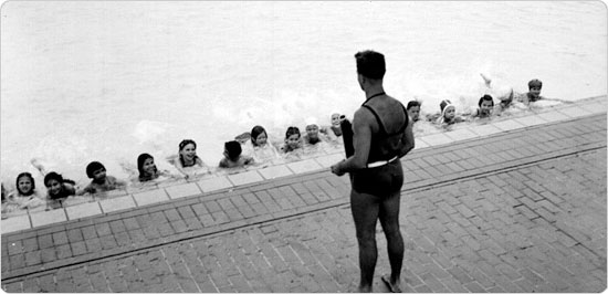 Image of An instructor leads a swim class on March 31, 1947.