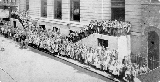 Image of A line forms in front of the Baruch Baths on Rivington Street.