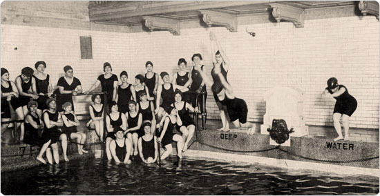 Image of Female swimmers practice at the East 23rd Street public bath around 1915. Neg. 53230.1.