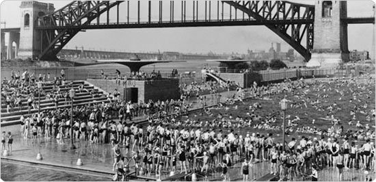 Image of Bird's eye view of Astoria Pool with bathers and Hell Gate Bridge in the background, August 20, 1936. Neg. 10776.2.