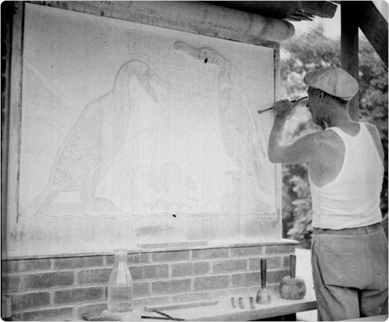 A sculptor works on bas reliefs for the Central Park Zoo, July 18, 1934. Courtesy of Parks Photo Archive, Neg. 3500.