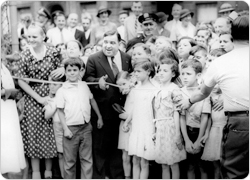 Mayor Fiorello LaGuardia cuts the ribbon, thus opening Dr. Gertrude B. Kelly Playground to the public, August 8, 1934.