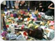 Image of Mourners leave gifts at the Imagine mosaic in honor of George Harrison on November 30, 2001, the day after his death. Photo by S.T. Tucker