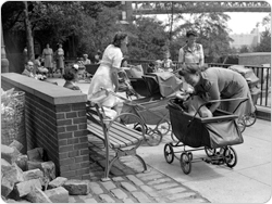 August 6, 1943 shot of mothers, strollers, and babies in the park.