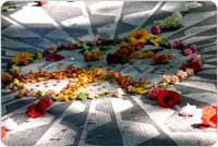Visitors frequently drape the Imagine monument in flowers as a tribute to John Lennon