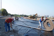 Image of Workers prepare the foundation for one of the Phase I soccer fields.