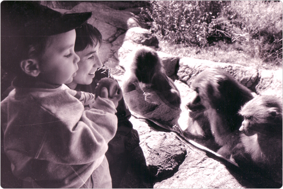 Lee Kuhn and mother Michele Herman enjoy the baboon exhibit at the Prospect Park Zoo opening on October 5, 1993. Photo by Simon Benepe.