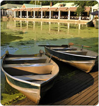 Docked Rowboats with Restaurant in background
