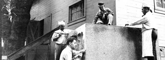 Artists transform a block of Coopersburg Granite into a pedestal for Madison Square Park's Admiral David Glasgow Farragut monument, circa 1936.