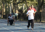 People with disabilities sporting in a park