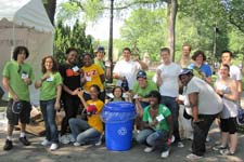 GreenTeam volunteers posing with a recycling can