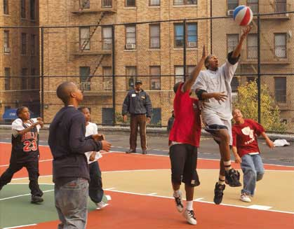 Basketball players at Rock Garden Park, Bronx.