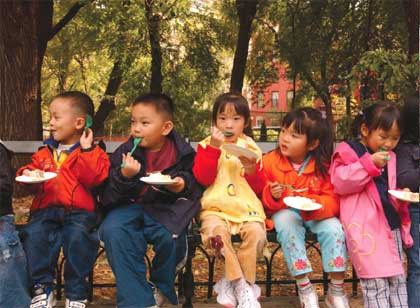 Children eat cake in the Lower East Side