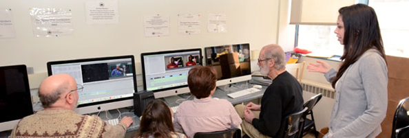 Computer Resource Center visitors work together on video project using Apple Macintosh computers