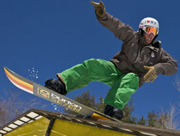 a snowboarder riding a rail