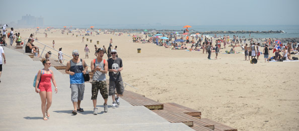 Teens enjoy new Rockaway boardwalk with hundreds of beachgoers in the background