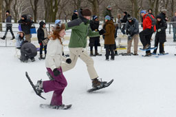 people snow shoeing