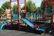 Children Play in Baisley Pond Park Playground