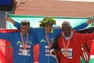 Second place Abderrahim Goumri of Ethiopia, first place Marilson Gomes dos Santos of Brazil, and third place Daniel Rono of Kenya