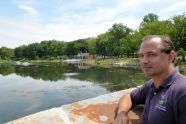 Commissioner Adrian Benepe surveys the restored Indian Lake