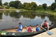 An Urban Park Ranger and his canoeing companions