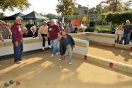 Bronx Parks Commissioner Hector Aponte tests his bocce skills on the court