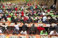 Scores of competitors concentrate on the game